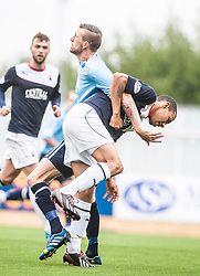 Dundee's Iain Davidson holds Falkirk's Phil Roberts.<br /> Falkirk 3 v 1 Dundee, 21/9/2013.<br /> ©Michael Schofield.