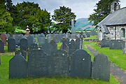 Church of St Michael and churchyard with Welsh slate gravestones at Llanfihangel-Y-Pennant in Snowdonia, Wales