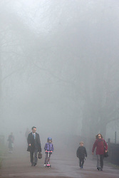 © Licensed to London News Pictures. 01/04/2014. Hammersmith, UK. Commuters travel across the park.  A foggy morning in Ravenscourt Park in Hammersmith West London today April 1st 2014. Photo credit : Stephen Simpson/LNP