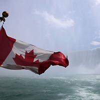 Canada, Ontario, Niagara Falls. Canadian flag on the Maid of the Mist at Niagara Falls.