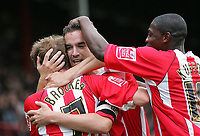 Photo: Lee Earle.<br /> Brentford v Bradford City. Coca Cola League 1. 02/09/2006. Brentford's Paul Brooker (L) and Jo Kuffour (R) congratulate Kevin O'Connor after he scored their first.