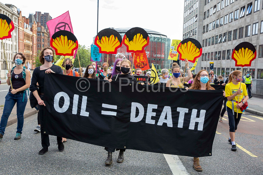 Extinction Rebellion 'Shell Out' protest crosses Waterloo Bridge on 8th September 2020 in London, United Kingdom. The environmental group gathered outside the Shell building to protest at the ongoing extraction of fossil fuels and the resulting environmental record. Extinction Rebellion is a climate change group started in 2018 and has gained a huge following of people committed to peaceful protests. These protests are highlighting that the government is not doing enough to avoid catastrophic climate change and to demand the government take radical action to save the planet.