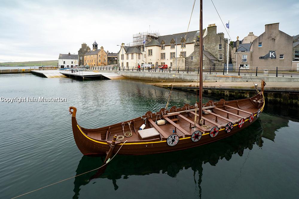 Seafront with replica Viking longboat in harbour in Lerwick, Shetland , Scotland, UK