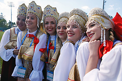 Women pose for a photo in traditional Russian clothing ahead the training session at the Spartak Zelenogorsk Stadium, Repino.