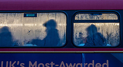 © Licensed to London News Pictures. 15/01/2020. London, UK. Commuters head to work on a bus this morning from Waterloo. A gloomy start for commuters at Waterloo this morning after a stormy night as more rain and high winds are expect for Thursday 16/01/2020. Photo credit: Alex Lentati/LNP