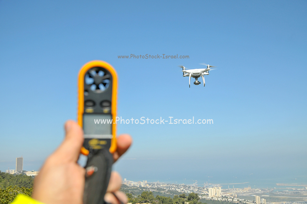Remote control Quadrocopter, drone, and Hand held weather station Anemometer and thermometer