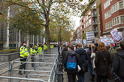 City of London police officers line up in front of the Home Office to observe thousands of students attending a National Demonstration for a Free Education on 4th November 2015 in London, United Kingdom. The demonstration was organised by the National Campaign Against Fees and Cuts (NCAFC) in protest against tuition fees and the Government's plans to axe maintenance grants from 2016.