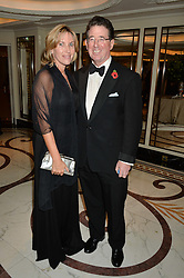 LORD & LADY GRIMTHORPE at the 24th Cartier Racing Awards held at The Dorchester, Park Lane, London on 11th November 2014.