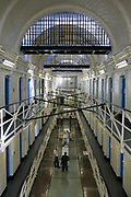 A view down E wing of HM Prison Wandsworth, a Category B men's prison at Wandsworth in the London Borough of Wandsworth, South West London, United Kingdom. It is operated by Her Majesty's Prison Service and is one of the largest prisons in the UK with a population over 1500 people. (photo by Andy Aitchison)