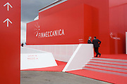 Delegates outside Italian aerospace and defence Finmeccanica's trade stand at the Farnborough Air Show, UK. Finmeccanica S.p.A. is an Italian conglomerate. Finmeccanica is the second largest industrial group and the largest of the hi-tech industrial groups based in Italy. It operates in seven sectors: Aeronautics, Helicopters, Space, Defence and Security Electronics, Defence Systems, Energy and Transportation. The company has offices in over 100 countries. It is partially owned by the Italian government, which holds about 30% of Finmeccanica's shares. The Farnborough International Airshow is a seven-day international trade fair for the aerospace industry and held every two years in mid-July, known as the home of British aviation, held since there since 1948. The show is usually attended by more than 1,300 exhibitors and 150,000 trade visitors.