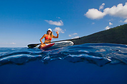 Woman on stand up paddle board (SUB), Kealakekua Bay, Big Island, Hawaii, Pacific Ocean.