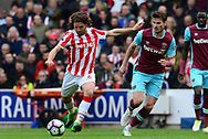 Joe Allen of Stoke city has a shot at goal.  Premier league match, Stoke City v West Ham Utd at the Bet365 Stadium in Stoke on Trent, Staffs on Saturday 29th April 2017.<br /> pic by Bradley Collyer, Andrew Orchard sports photography.