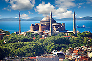 The exterior of the 6th century Byzantine (Eastern Roman) Hagia Sophia ( Ayasofya ) built by Emperor Justinian. The size of the dome was un-surpassed until the 16th century, Istanbul, Turkey .<br /> <br /> If you prefer to buy from our ALAMY PHOTO LIBRARY  Collection visit : https://www.alamy.com/portfolio/paul-williams-funkystock/hagia-sophia-istanbul.html<br /> <br /> Visit our TURKEY PHOTO COLLECTIONS for more photos to download or buy as wall art prints https://funkystock.photoshelter.com/gallery-collection/3f-Pictures-of-Turkey-Turkey-Photos-Images-Fotos/C0000U.hJWkZxAbg
