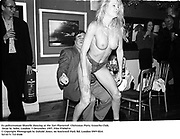 Ex policewoman Sharelle dancing at the 'Get Plastered'  Christmas Party. Groucho Club, Dean St. Soho, London. 5 December 1997<br />Film 97696f14<br />© Copyright Photograph by Dafydd Jones<br />66 Stockwell Park Rd. London SW9 0DA<br />Tel 0171 733 0108