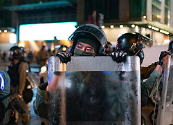 Hong Kong, China. 13th October 2019. Woman suspected of being pro-Beijing is assaulted by pro-democracy protestors in Mongkok district in Kowloon on Sunday evening. This incident was one of several throughout Hong Kong on Sunday which saw acts of vandalism carried out by a minority in the pro-democracy movement.  Iain Masterton/Alamy Live News.