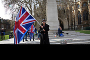 Anti Brexit pro Europe demonstrator waving an EU and Union Jack flag in Westminster on 26th March 2019 in London, England, United Kingdom. With the date of the UK leaving the European Union extended, the pro EU protest continues as MPs from all sides try to gain control of the process.