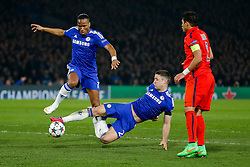 Didier Drogba and Gary Cahill of Chelsea go for the same ball as Thiago Silva of Paris Saint-Germain looks on - Photo mandatory by-line: Rogan Thomson/JMP - 07966 386802 - 11/03/2015 - SPORT - FOOTBALL - London, England - Stamford Bridge - Chelsea v Paris Saint-Germain - UEFA Champions League Round of 16 Second Leg.