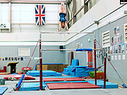 Gymnast, Beth Tweddle training on the uneven bars at the City of Liverpool Gymnastics club, UK prior to the 2012 London Olympic Games. A three-time Olympian, Beth Tweddle competed in the 2004 Athens, 2008 Beijing, and 2012 London Olympic Games, where she took home a bronze medal on the uneven bars, the first Olympic medal for a British female gymnast. Tweddle retired in August 2013.