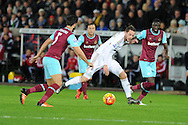 Gylfi Sigurdsson of Swansea city © looks for a way through. Barclays Premier league match, Swansea city v West Ham Utd at the Liberty Stadium in Swansea, South Wales  on Sunday 20th December 2015.<br /> pic by  Andrew Orchard, Andrew Orchard sports photography.
