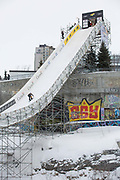 A snowboarder dropping into the FIS Jamboree Big Air on 09th February 2017 in downtown Quebec, Canada. The Canadian Jamboree is part of the ski and snowboard FIS World Cup circuit held in Quebec City and Stoneham Mountain.