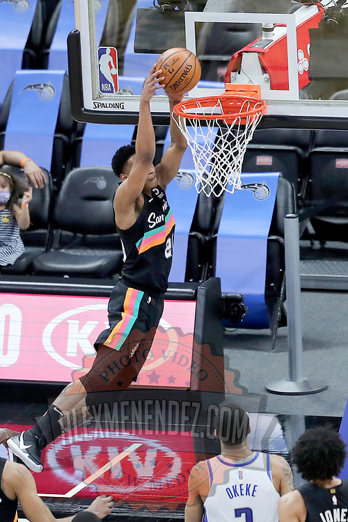 ORLANDO, FL - APRIL 12: Devin Vassell #24 of the San Antonio Spurs slam dunks the ball against the Orlando Magic during the second half at Amway Center on April 12, 2021 in Orlando, Florida. NOTE TO USER: User expressly acknowledges and agrees that, by downloading and or using this photograph, User is consenting to the terms and conditions of the Getty Images License Agreement. (Photo by Alex Menendez/Getty Images)*** Local Caption *** Devin Vassell