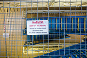 'Warning Keep Off the Netting' sign. Suicide netting above a stairway on Drake wing, HMP/YOI Portland, a resettlement prison with a capacity for 530 prisoners.