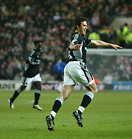Photo. Andrew Unwin.<br /> Southampton v Newcastle United, FA Cup Third Round, Friends Provident St Marys Stadium, Southampton 03/01/2004.<br /> Newcastle's Laurent Robert (r) celebrates scoring his team's second goal.