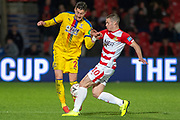 Crystal Palace defender Joel Ward (2) is tackled by Doncaster Rovers midfielder Tommy Rowe (10) during the The FA Cup 5th round match between Doncaster Rovers and Crystal Palace at the Keepmoat Stadium, Doncaster, England on 17 February 2019.