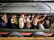 15 SEPTEMBER 2017 - BANGKOK, THAILAND: Passengers on a Khlong Saen Saeb passenger boats at the Asok Pier, on Sukhumvit Soi 21. Tens of thousands of passengers ride the boat every day, commuting into Bangkok from the eastern suburbs.      PHOTO BY JACK KURTZ