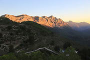 Rocky mountain peaks at sunset near Xalo or Jalon, Marina Alta, Alicante province, Spain