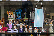 "A face covering and souvenirs are pictured in the window of a closed gift shop during the second coronavirus lockdown on 9th November 2020 in Windsor, United Kingdom. Only retailers selling ""essential"" goods and services are permitted to open to the public during the second lockdown."