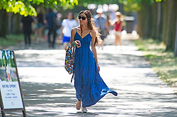 ©Licensed to London News Pictures 31/07/2020     Greenwich, UK. This young lady wearing a blue summer dress in Greenwich park, Greenwich, London. Today is set to be the hottest day of the year so far with temperatures to hit 35C in parts of the UK. Photo credit: Grant Falvey/LNP