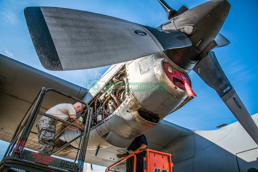 """Senior Airman Tim Johnson and Senior Airman Hunter Mitchell, both 179th Airlift Wing Maintenance Group aerospace propulsion specialists, , evaluate an engine of the C-130H Hercules while it is running June 26, 2018, in Mansfield, Ohio. The diagnostic test requires the engine to be running for the Airman to properly identify the cause of this particular issue and is also known by aircraft mechanics as """"man on the stand."""" (U.S. Air National Guard photo by Capt. Paul Stennett)"""