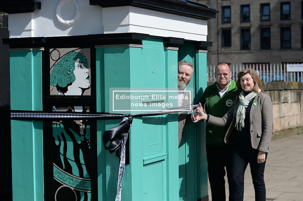 Scottish Green party candidates for the Lothians Alison Johnstone (right) and Andy Wightman (centre) officially unveil the latest piece of art by Leith-based artist Stewart Bremner (left), a specially-designed and painted decommissioned police box on Leith Walk, Edinburgh.<br /> <br /> <br /> © Dave Johnston/ EEm