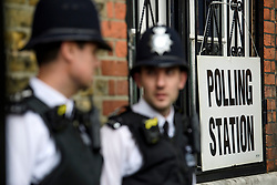 © Licensed to London News Pictures. 08/06/2017. London, UK. Police officers watch over before Leader of the Labour Party Jeremy Corbyn votes at a school in his constituency of Islington North in London. Earlier this year British prime minister Theresa may Prime Minister Theresa May received the necessary two-thirds majority vote in parliament to call a snap election. Photo credit: Ben Cawthra/LNP
