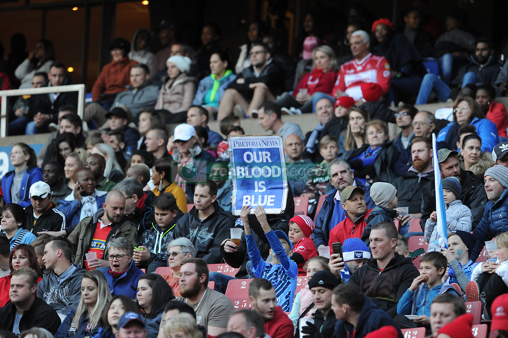 14-07-18 Johannesburg. Emirates Airlines Park. Emirates Lions vs Vodacom Blue Bulls.<br /> 2nd half. A young Bulls supporter holds a Pretoria News poster. <br /> Picture: Karen Sandison/African News Agency (ANA)