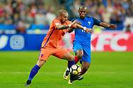 France's defender Djibril Sidibe challenges Netherlands' midfielder Wesley Sneijder during the FIFA World Cup Russia 2018, Qualifying Group A football match between France and Netherlands on August 31, 2017 at the Stade de France in Saint-Denis, north of Paris, France - Photo Benjamin Cremel / ProSportsImages / DPPI