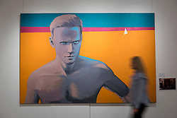 """© Licensed to London News Pictures. 03/06/2016. London, UK. A staff member walks in front of Georgy Gurianov's """"Self-Portrait"""" (est. GBP 80,000-120,000), at a preview of Sotheby's Russian and contemporary central and eastern European art sale which takes place in London on 7 June. Photo credit : Stephen Chung/LNP"""
