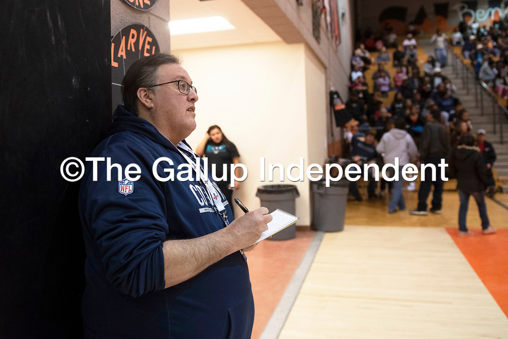 Sports editor at the Gallup Independent Alan Arthur takes notes at the Gallup-Bloomfield boys varsity basketball game Friday Feb. 14 in Gallup. Wednesday, Feb. 19 was Arthur's last day at the Independent after working at the newspaper for 32 years.