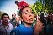 """A gypsy woman sings a """"salve"""" in the traditional stop across the river at Vado del Quema point."""