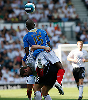 Photo: Steve Bond. <br />Derby County v Portsmouth. Barclays Premiership. 11/08/2007.  Silvain Distin (top) climbs all over Steve Howard (bottom) and a foul is given