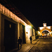 The famous Santa Catalina Arch in downtown Antigua, Guatemala, connecting two parts of a convent across one of the town's main cobblestone streets.