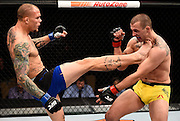 LAS VEGAS, NV - DECEMBER 03:  (L-R) Anthony Smith kicks Elvis Mutapcic of Bosnia in their middleweight bout during The Ultimate Fighter Finale event inside the Pearl concert theater at the Palms Resort & Casino on December 3, 2016 in Las Vegas, Nevada. (Photo by Jeff Bottari/Zuffa LLC/Zuffa LLC via Getty Images)