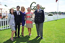 Left to right, Managing Director Cartier UK FRANCOIS LE TROQUER and his wife LIUDMILA, CHRISTIE BRINKLEY and ARNAUD & CARLA BAMBERGER at the 27th annual Cartier International Polo Day featuring the 100th Coronation Cup between England and Brazil held at Guards Polo Club, Windsor Great Park, Berkshire on 24th July 2011.