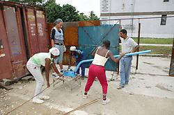 Women cutting steel rods on a building site in Havana; Cuba,