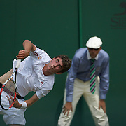 George Morgan, Great Britain in action against Bernard Tomic, Australia,  in the Boy's Singles competition at the All England Lawn Tennis Championships at Wimbledon, London, England on Saturday, June 27, 2009. Photo Tim Clayton.