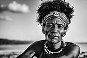 A black and white portrait of a man from the Turkana tribe with his feathered head dress, Lake Turkana, Loiyangalani,Kenya, Africa