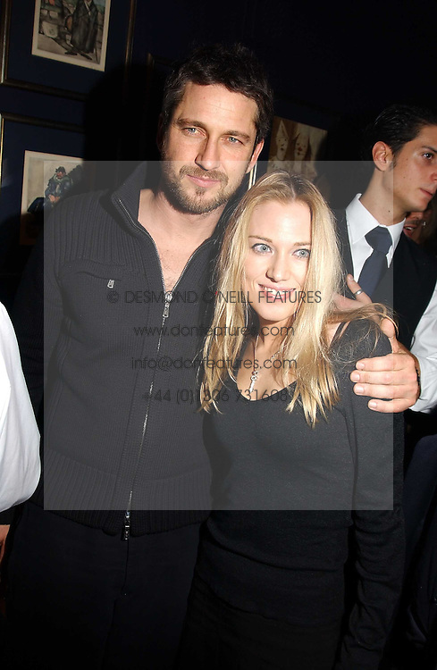 IMOGEN LLOYD WEBBER and GERALD BUTLER at a party hosted by Tatler magazine to celebrate the publication of the 2004 Little Black Book held at Tramp, 38 Jermyn Street, London SW1 on 10th November 2004.<br /><br />NON EXCLUSIVE - WORLD RIGHTS