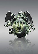Roman decoration panel of Medusa from a Roman ship, the age of Calligula, 37-41 AD, made from bronze. The head of the medusa is an example of refined craftsmanship. The detail of the hair, the scales, the snakes and the nostrils were made using hand held tools . the work is at its most frightening when viewed from a low anyle suggesting that it was designed to be places high up on the ship .  The National Roman Museum, Rome, Italy .<br /> <br /> If you prefer to buy from our ALAMY PHOTO LIBRARY  Collection visit : https://www.alamy.com/portfolio/paul-williams-funkystock/roman-museum-rome-sculpture.html<br /> <br /> Visit our ROMAN ART & HISTORIC SITES PHOTO COLLECTIONS for more photos to download or buy as wall art prints https://funkystock.photoshelter.com/gallery-collection/The-Romans-Art-Artefacts-Antiquities-Historic-Sites-Pictures-Images/C0000r2uLJJo9_s0