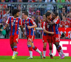 MUNICH, GERMANY - OCTOBER 18: Xabi Alonso of Bayern Munich celebrates scoring a goal  during the Bundesliga match between Bayern Munich and Werder Bremen. October 18, 2014 in Munich, Germany. Photo mandatory by-line: Mitchell Gunn